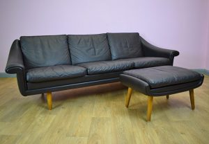The New Used Black Vinyl Couch